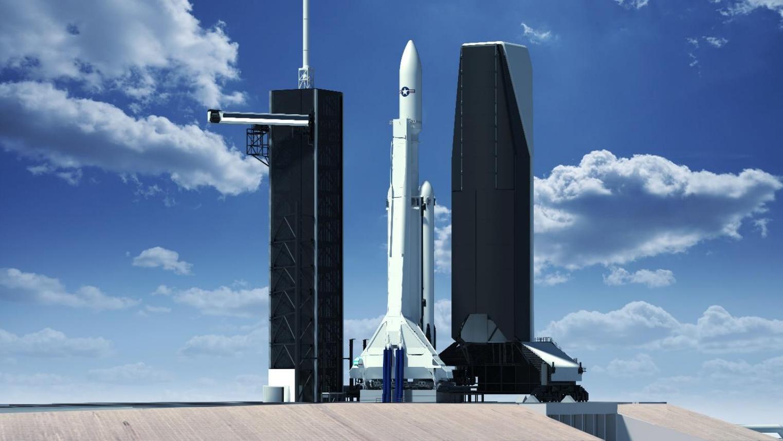 Grafika przedstawiająca rakietę Falcon Heavy oraz wieżę serwisową na platformie LC-39A (Źródło: FAA/SpaceX)